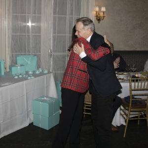 Southampton's Top Producer Michael Gary gets a hug from Judi Desiderio